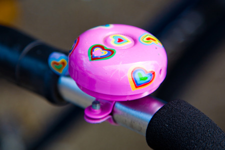 bycicle: bycicle bell with hearts on a bike. Stock Photo