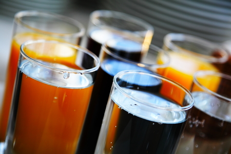 carbonated drink: Carbonated beverages. lemon orange and cola drink in glasses at an event.