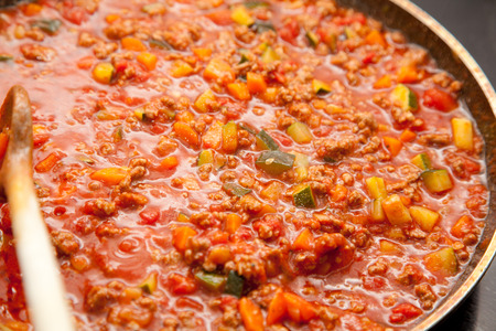 pasta sauce: pan with sauce bolognese. Italian pasta sauce with carrots, zuccini and tomatoes.