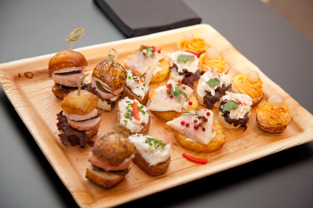 fingerfood: fingerfood on a tray at an event or fair.
