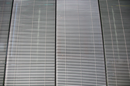 blinds: metal blinds background texture. blinds at an office building.