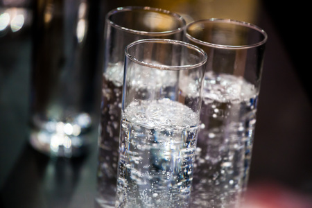 sparkling water: three glasses with sparkling water. Stock Photo