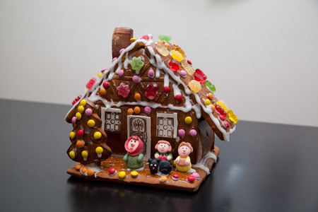 small house: gingerbread house with small Figures. Stock Photo