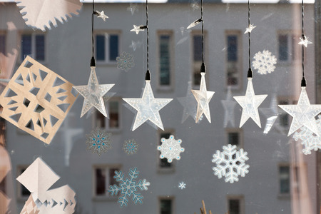 december: window with star decoration at christmas time in december Stock Photo