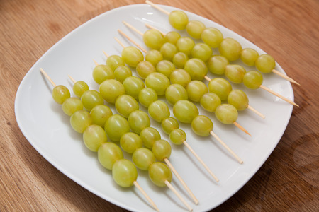 glazing: Green grapes on sticks before glazing.