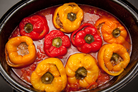 capsicum: Filled capsicum in casserole with tomato sauce in the kitchen.