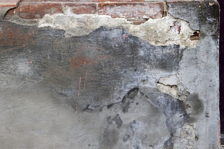 Old concrete wall with a layer of whitewash, mold texture decay
