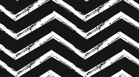 Hand drawn vector abstract rough geometric monochrome seamless zig zag chevron pattern in black and white colors.Hand made grunge brush painted texture.Scandinavian concept design for fashion,fabric.