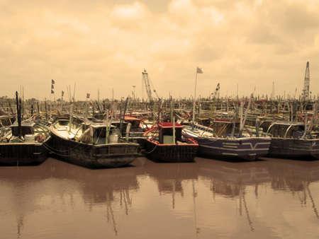 Fishing Boats on Harbor Stock Photo