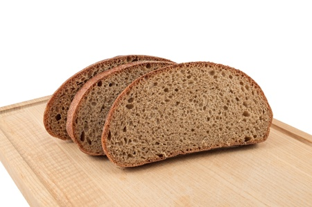 The cut bread on a chopping board on a white background photo