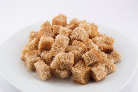 crackling: Croutons on a plate on a white background Stock Photo