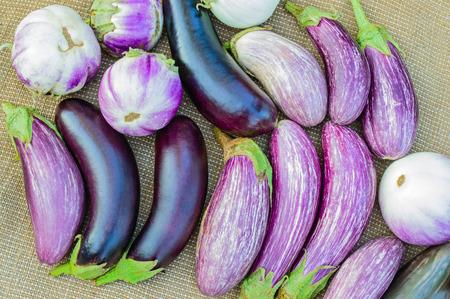 sacking: Ripe eggplants on a sacking background