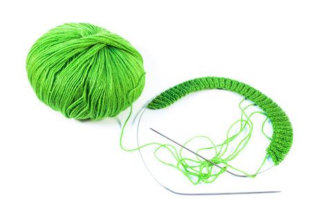 spoke: Beige wool yarn ball and spoke on a white background Stock Photo