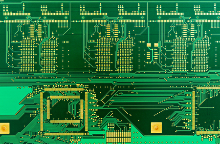 pcb: The  blank green printed circuit board (PCB) with gilded contacts, isolated on white