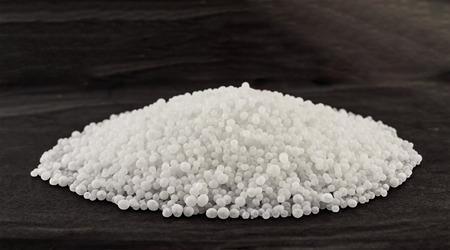 urea: Mineral fertilizers balls - carbamide (urea) on a black background Stock Photo