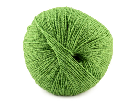 Green yarn clew closeup isolated on the white background