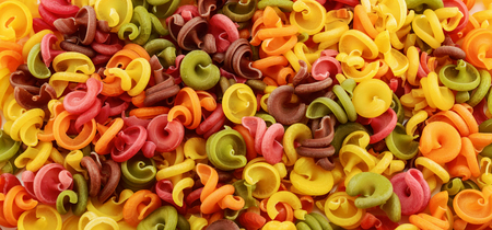 Dry italian pasta in five colours. Background Stock Photo