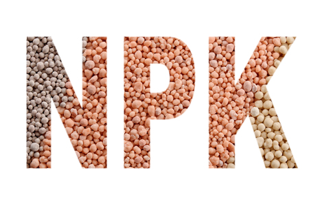 NPK letters made of mineral fertilizers background. N - nitrogen, P - phosphorus, K - potassium (kalium)