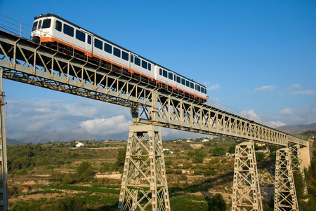 narrow gauge: Narrow gauge train crossing a bridge in scenic location