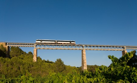 narrow gauge: A narrow gauge train crossing a bridge over vineyards Stock Photo