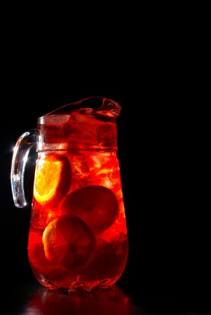 Jug of chilled Spanish sangria with fresh fruit photo