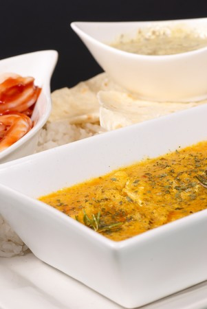 red gram: Chicken korma curry served with rice, onions and wraps