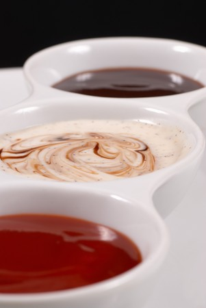 A choice of dips served in a multiple bowl