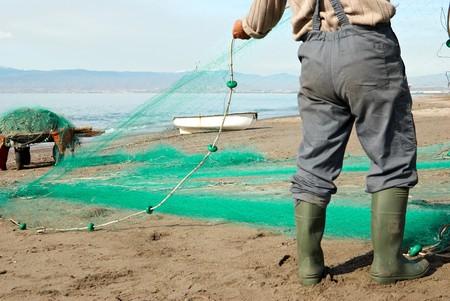 trawler net: Repairing the  nets