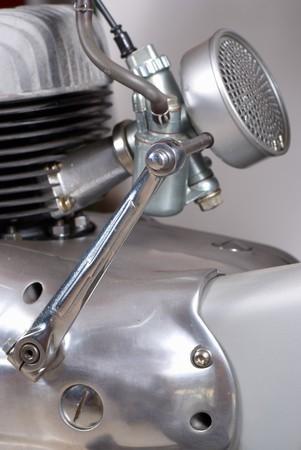 Kick starter device on a classic motorbike engine photo