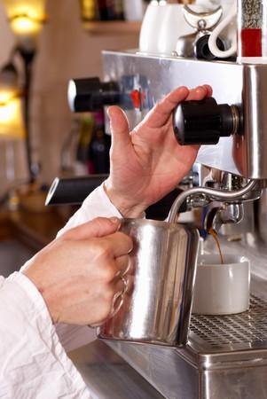 Operating a professional coffe machine  photo