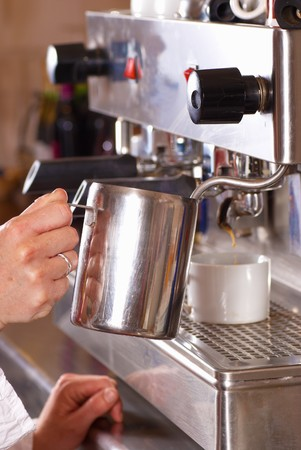 percolate: Operating a professional italian coffee machine in a cafe Stock Photo