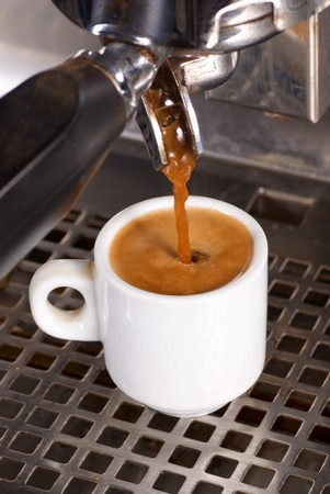 Preparing a strong cofffe with a professional coffee machine photo
