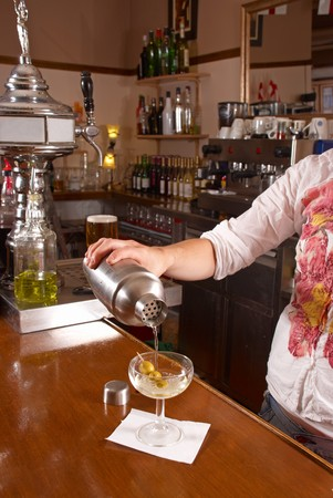 Pouring a cocktail in a traditional bar photo