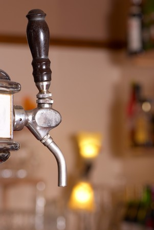 Detail of a beer draft tap in a pub