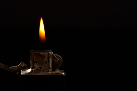 Ignited classic gasoline lighter with copy space