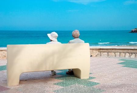 Sunny retirement for a senior couple on a sunny beach photo