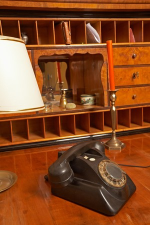 Still life, biedermeier cherry wood cabinet and old phone Stock Photo - 7392640