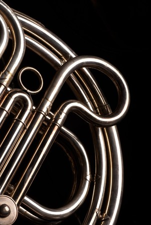 french horn: Detail of the coiled pipes of a French horn