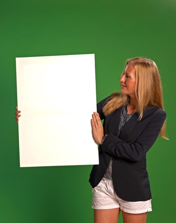 A woman holding an empty white board ready for displaying text Stock Photo - 7618875