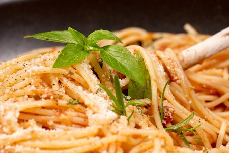 Closeup of freshly made spaghetti with basil photo