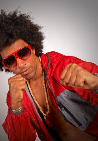 Afro male in urban wear threatening to punch photo