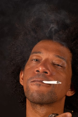 African american male after lighting a spliff