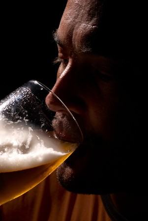Guy enjoying is cold pint after a hot day Stock Photo - 7749467