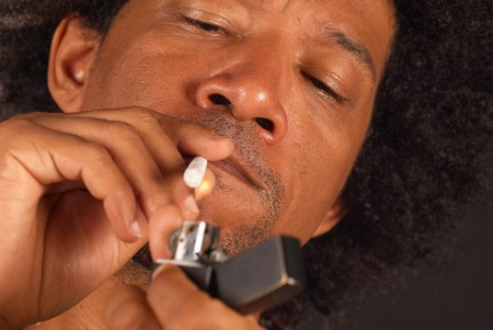 jamaican man: African american male about to light a spliff