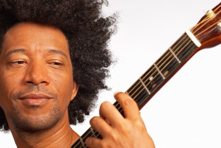 African american guitarist, closeup take while performing photo