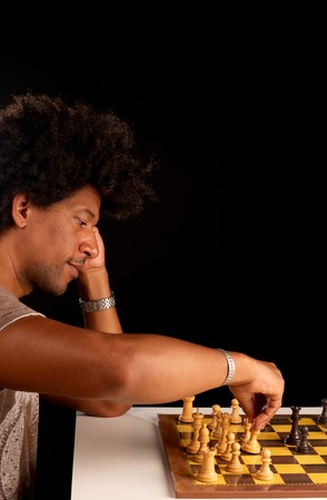 African american man concentrated while playing chess Stock Photo - 7749488