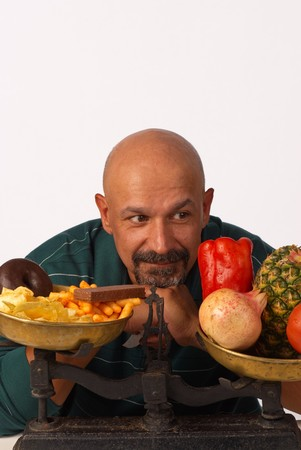 Making a decision between healthy and unhealthy food Stock Photo - 7749524