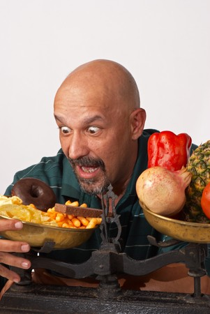 Guy about to fail in his effort to keep up a diet photo