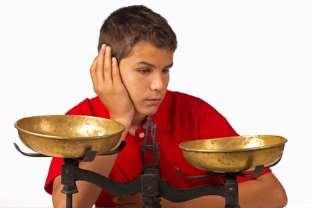 pros: Teenager thinking of the pros and contras Stock Photo