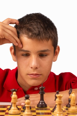 Teenager in full concentration while playing chess Stock Photo - 7749530